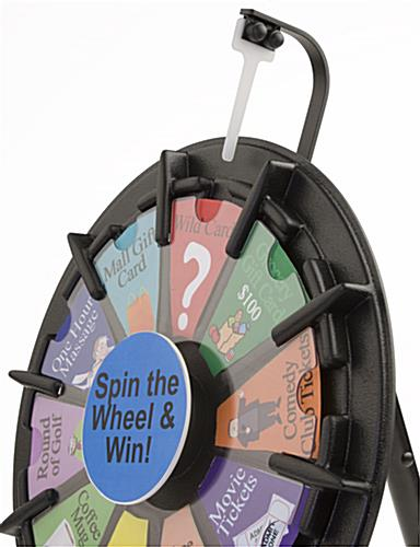 this prize wheel gathers an audience new inserts for this. Black Bedroom Furniture Sets. Home Design Ideas