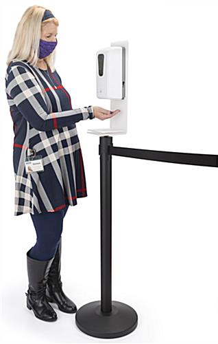 Hand sanitizer stanchion topper is battery operated
