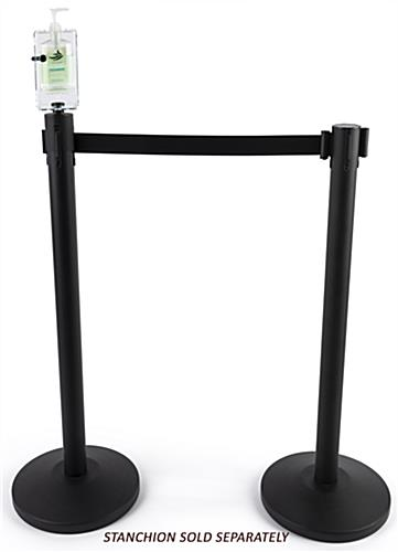 Locking hand sanitizer stanchion topper with rotating axle