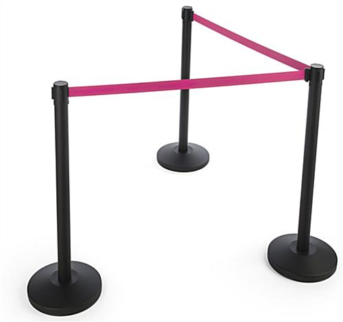 Retractable pink belt stanchion barrier for crowd control setups