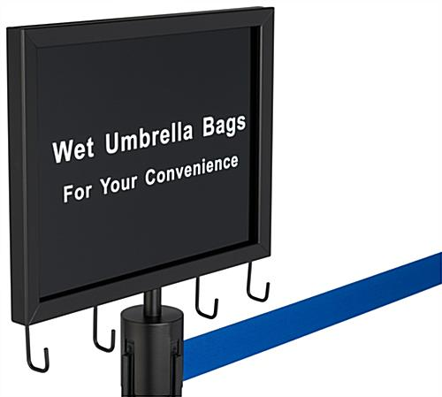 The 2-stanchion umbrella bag set with blue belt includes a sign with pre-printed message and hooks for hanging courtesy bags