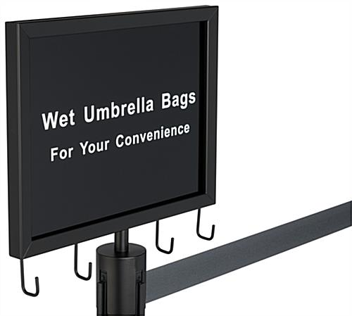 Gray belt stanchion umbrella station with welded hooks for courtesy bags