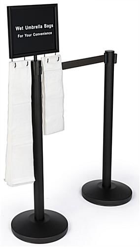 Gray belt stanchion umbrella station with 2 posts and signage