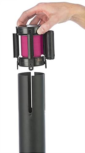 Pink belt crowd control stanchion with swappable cassette