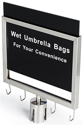 Silver stanchions with umbrella bag holder and pre-printed message in white text on a black background