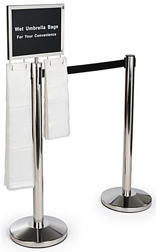 Silver stanchions with umbrella bag holder and safety-conscious signage