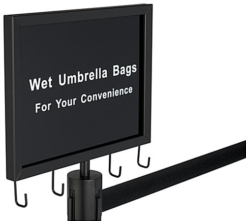 Black stanchions with umbrella bags includes sign frame and built in hangers