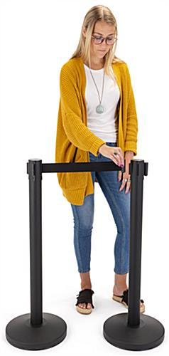 Retractable barrier stanchion stands 36 inches tall