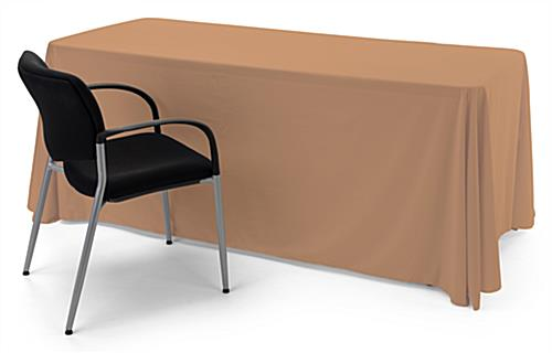 Beige polyester table cover fits perfectly on a 6' table