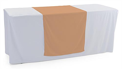Beige table runner with hemmed edge