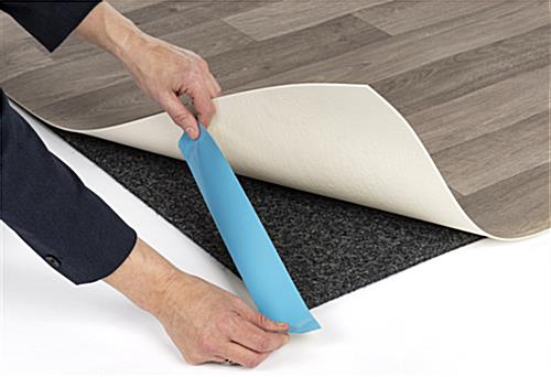 Simple installation of portable rollable vinyl event flooring