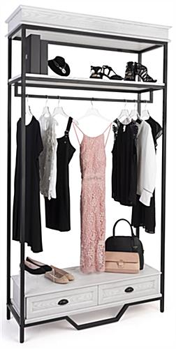 Farmhouse industrial clothing rack has a shelf capacity of 100 pounds