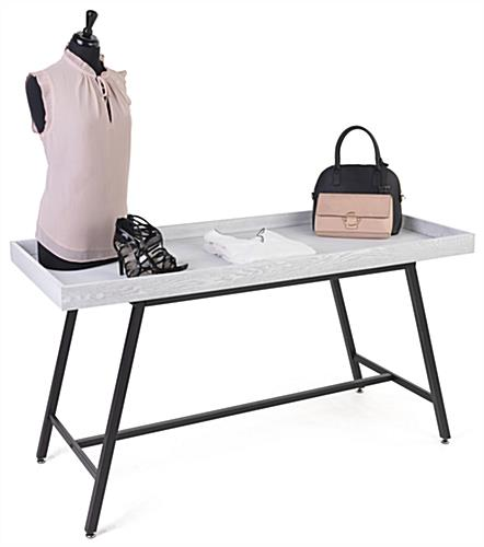 Store dump table with 59 inch by 25 inch merchandise area