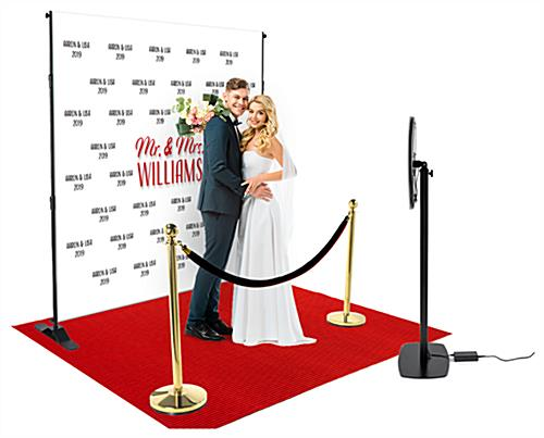 Step and repeat selfie station with red carpet and dimmable UV light ring