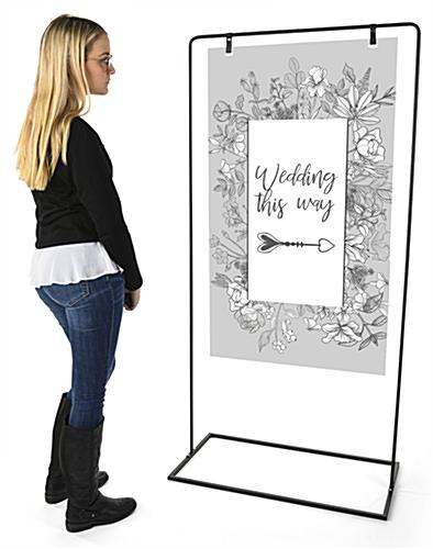 Minimalist sign stand with overall height of 68.5 inches