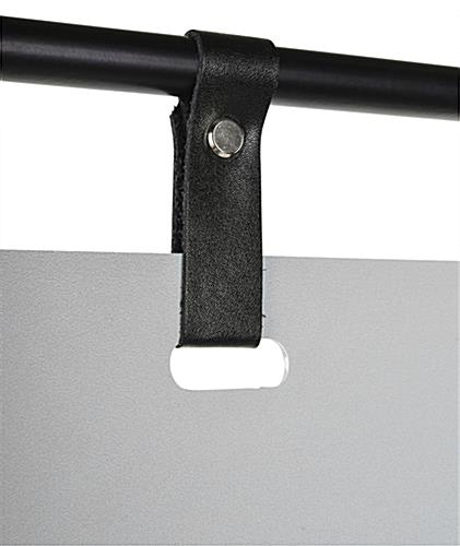 Minimal hanging signage stand with sleek faux black leather straps