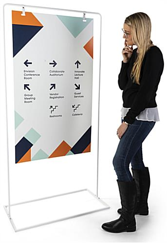 Minimalist white signage stand with a height of 68.5 inches