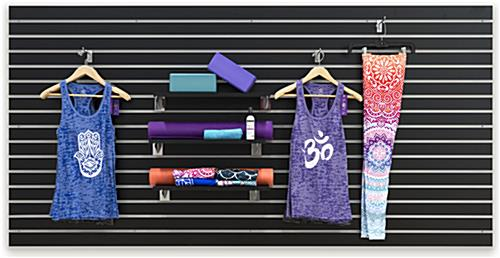 Yoga Clothes and Accessories on Large Black Slat Board Display Panel