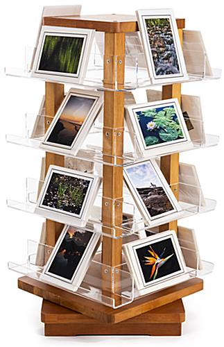 Spinning wooden literature holder includes 16 acrylic shelves