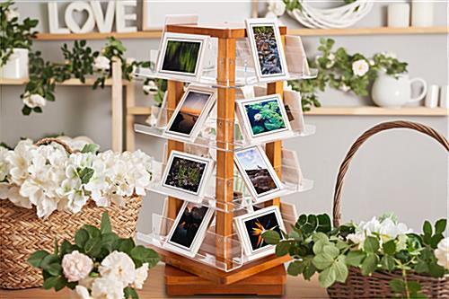Spinning wooden literature holder with multiple tiers of clear acrylic shelving