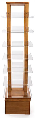 Four-sided revolving wood literature rack measures 16 inches wide by 70 inches tall