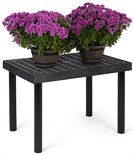 Durable outdoor display table is made of recyclable plastic material