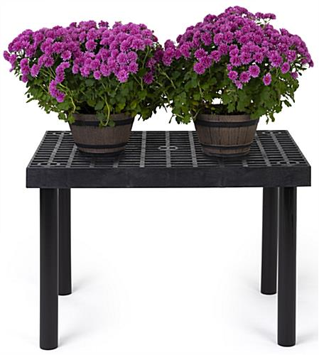 Outdoor display table with weather resistant design