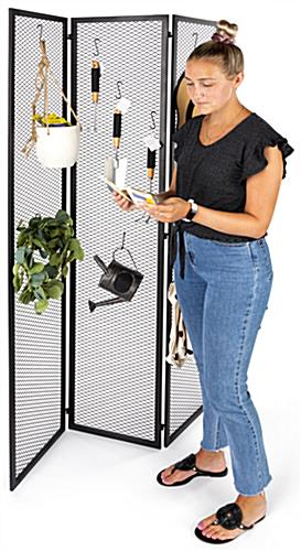 Hinged mesh retail display screen with overall dimensions of 45 inches wide by 72 inches tall