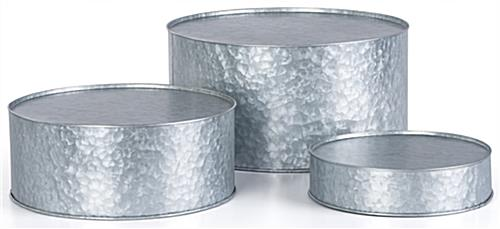 Round galvanized risers with hand-applied distressing technique