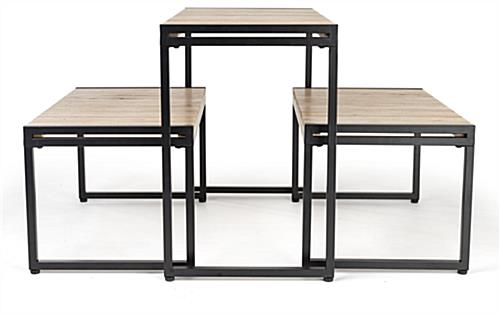 Large nesting tables have slatted wood surface