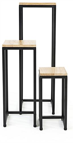 Wooden display tables with pine natural wood and black metal