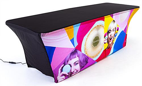 Black stretch top and back on 8' event table package with custom spandex cover and LED light kit