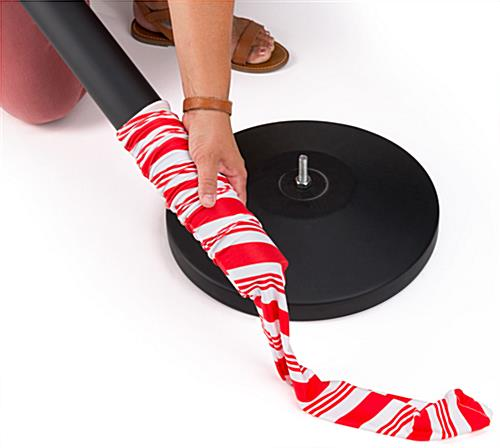 Seasonal cover for stanchion with candy cane stripe