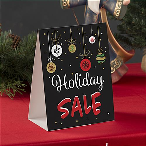 Seasonal tabletop promo sign with pre-printed message