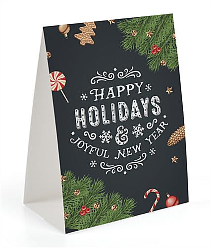 Happy holidays chalkboard printed table tent with green spruce swags