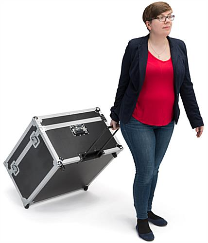 Trade show floor tile carrying case shown with extendable pull handle