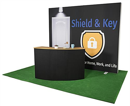 Pop up custom counter shown with branded matching booth accessories