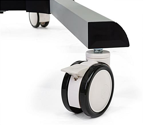 Dual monitor floor stand with shock-absorbing wheels