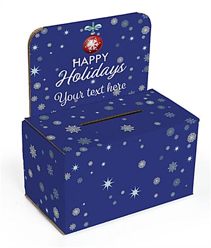 Cardboard holiday donation box with snowy blue theme