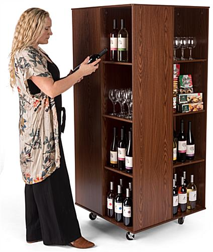 Rotating floor cube store display for liquor stores