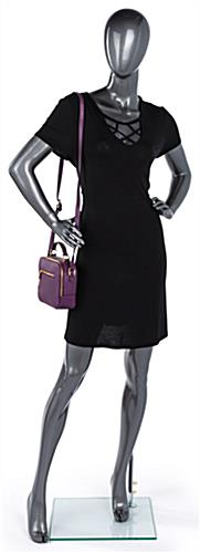 Gray female abstract mannequin with tempered glass base