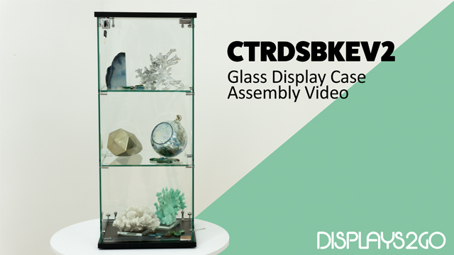 The countertop glass display case from Displays2go is a fun project to assemble that uses only simple tools and minimal experience. Watch Matt as he lines up the panels, slides them in the grooves, and screws them in with the hole connectors for a finished product in just a few easy steps. He also contributes some tips and pointers, like temporarily loosening the front-panel screw while adding in the glass door. Follow these instructions and your new glass display case will be a stable, sturdy addition to your countertop showcase!